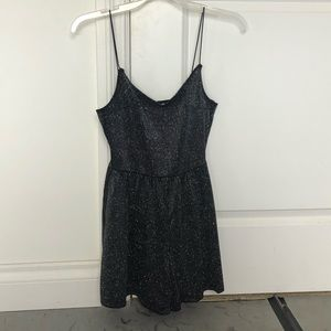 women's black and sparkly pin-striped romper